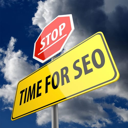 A sign saying stop, time for seo
